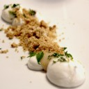 Ricotta cheese and pear dessert with biscuits, young oregano and thyme